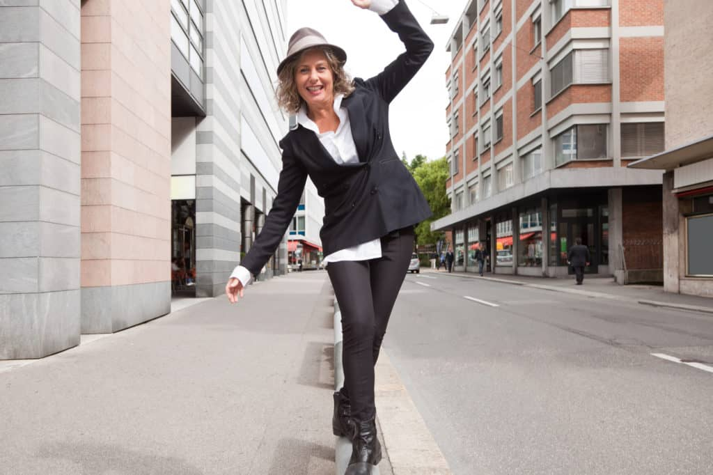 Main Graphic of Woman Balancing on Siidewalk for article Are You Walking a Social Media Tightrope by Sue-Ann Bubacz on Write Mix for Business with photo credit to depositphotodotcom