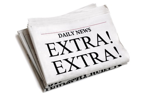 Daily newspaper showing Newspaper headline Extra Extra isolated on white background