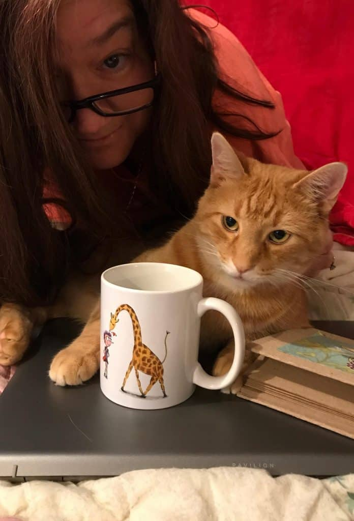 "Visual 3 for post by Sue-Ann Bubacz for Write Mix for Business showing pic of me with a HennekeD created ""Henrietta Magical Mug"" called Cup of Kindness and showing my and my kitty Tino hanging with laptop and kindness mug!"