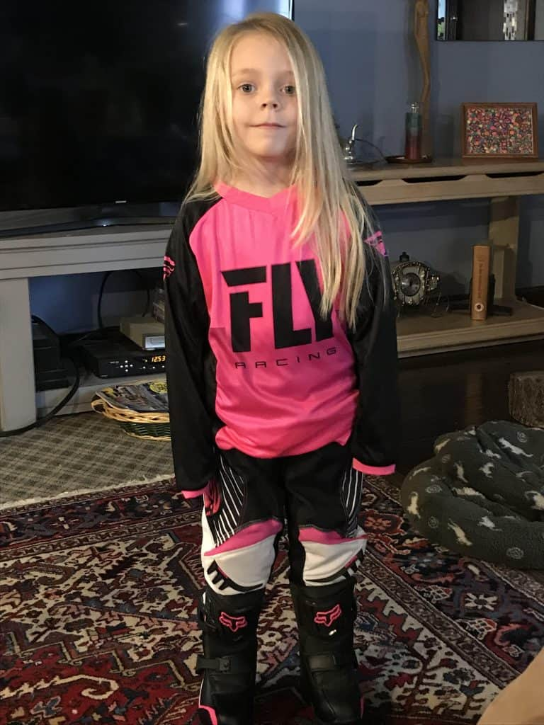 Ryder Wetzel at 4 years old thinking about riding her new motorcycle but at least she has the gear on!